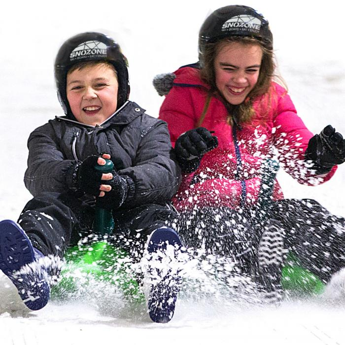 sledging on real snow at Snozone this half term